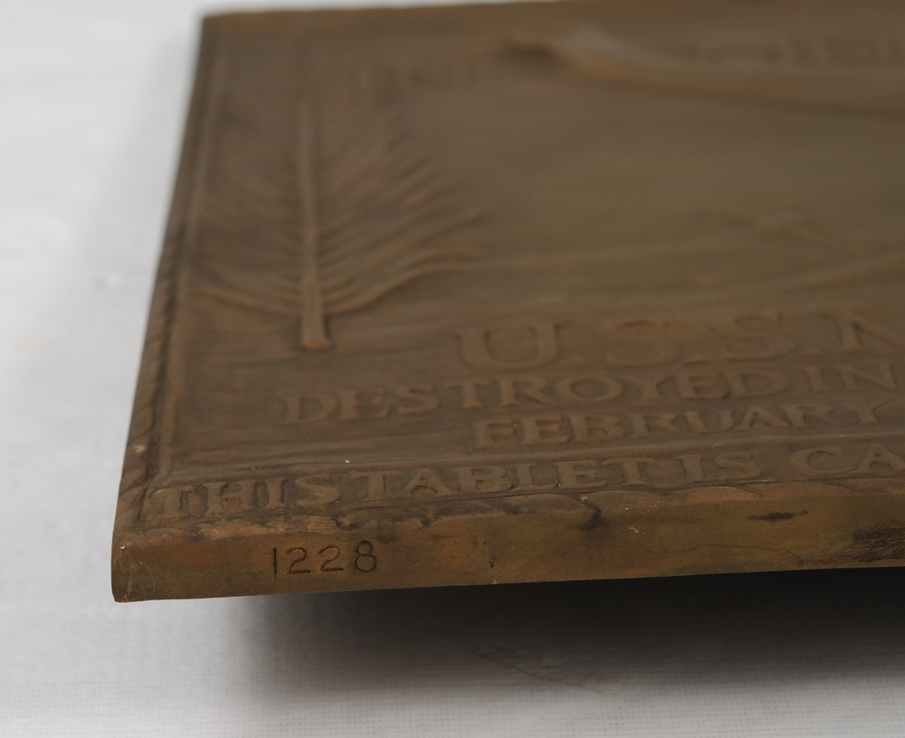 Plaque made from metal removed from USS Maine, serial number stamped on edge of plaque