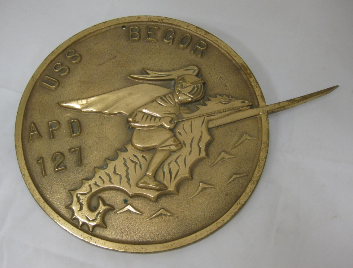 Round Bronze plaque with knight riding seahorse