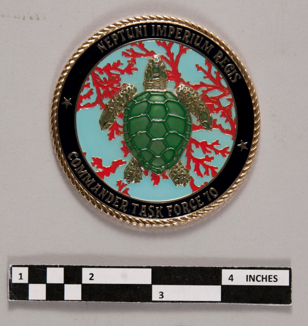 <p>Reverse of shellback coin Turtle and coral in vibrant colors blue, red, green</p>