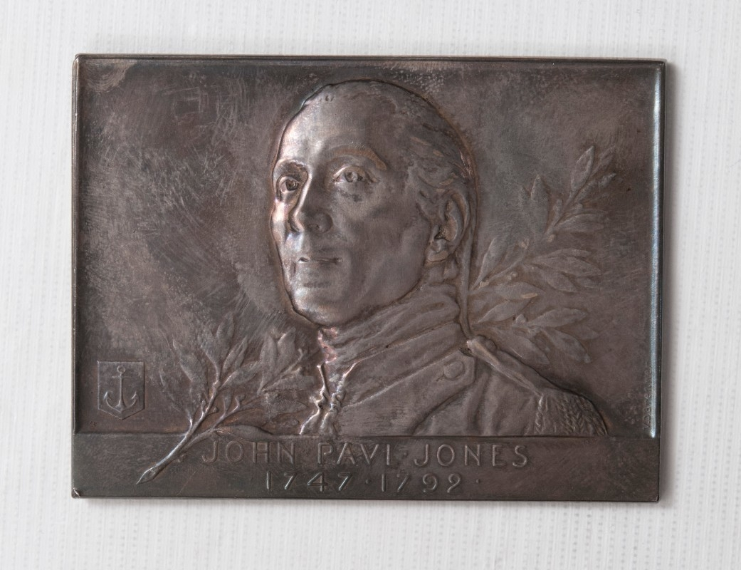 <p>silver rectangular medal with bust of John Paul Jones 1747-1905&nbsp;</p>