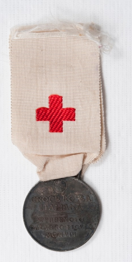 One white ribbon and red cross with a medallion marking Earthquake Relief in Italy 1909 Reverse of Medal