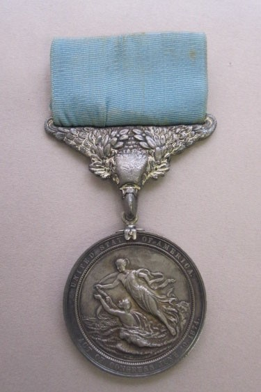 Version 2 silver lifesaving medal with blue ribbon given to lt nimitz for saving another sailor