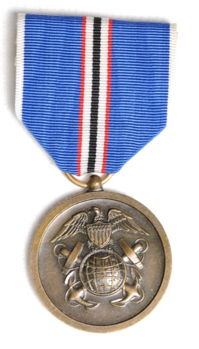 <p>Round bronze planchet with insingia of US Coast and geodetic Survey ribbon is blue with red, white and black pinstripes</p>