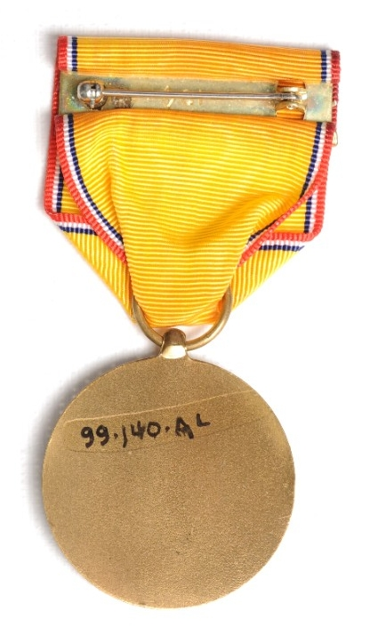 <p>Reverse image of US Coast and Geodetic Survey Defense Service Medal with pin and clasp visible</p>