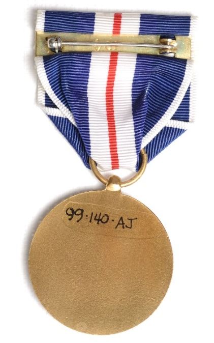 <p>Reverse of Distinguished Service Medal US Coast and Geodetic Survey with pin and clasp</p>