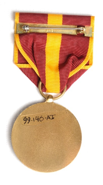 <p>reverse of US Coast and Geodetic Survey Good Conduct Medal with pin and clasp visible</p>