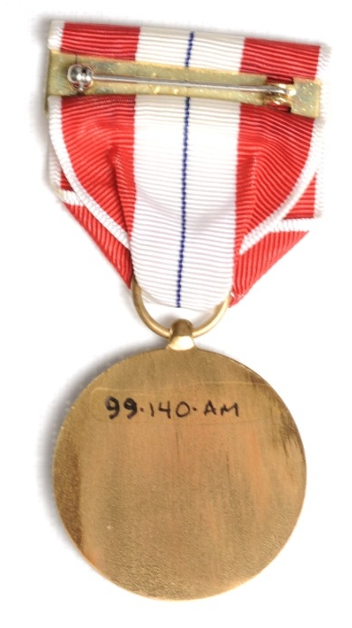<p>Reverse image of US Coast and Geodetic Survey Meritorious Survey Medal with pin and clasp bar visible</p>