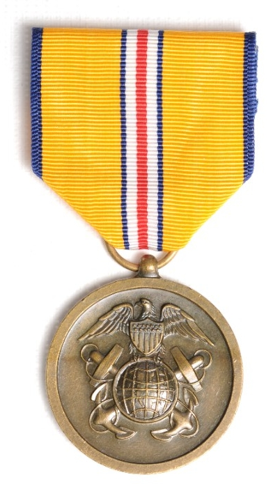 <p>Round bronze planchet with insignia of US Coast and Geodetic Survey attached to ribbon of yellow with thin blue white and red pinstripes in center.</p>