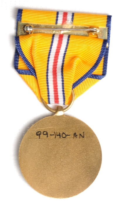 <p>Reverse image of US Coast and Geodetic Survey Pacific Warzone Medal with pin and clasp visible</p>