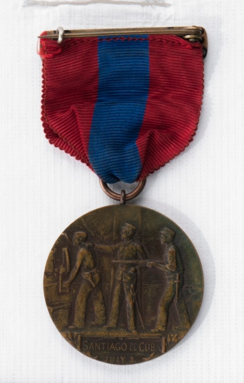 Reverse of West Indies Campaign medal raised image of soldiers with rifles