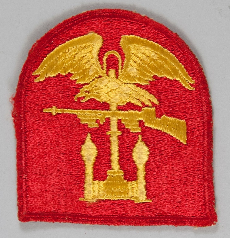 <p>Gold embroidered patch on red field. depiction is eagle machine gun and anchor</p>