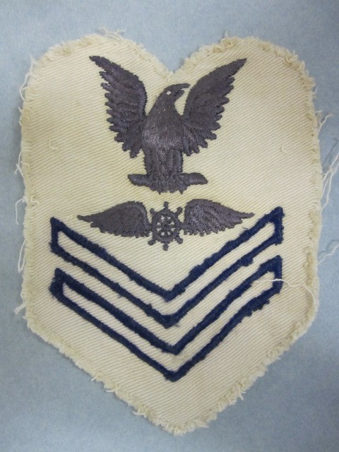 one white rating badge with sewn blue stitching Quartermaster Aviation