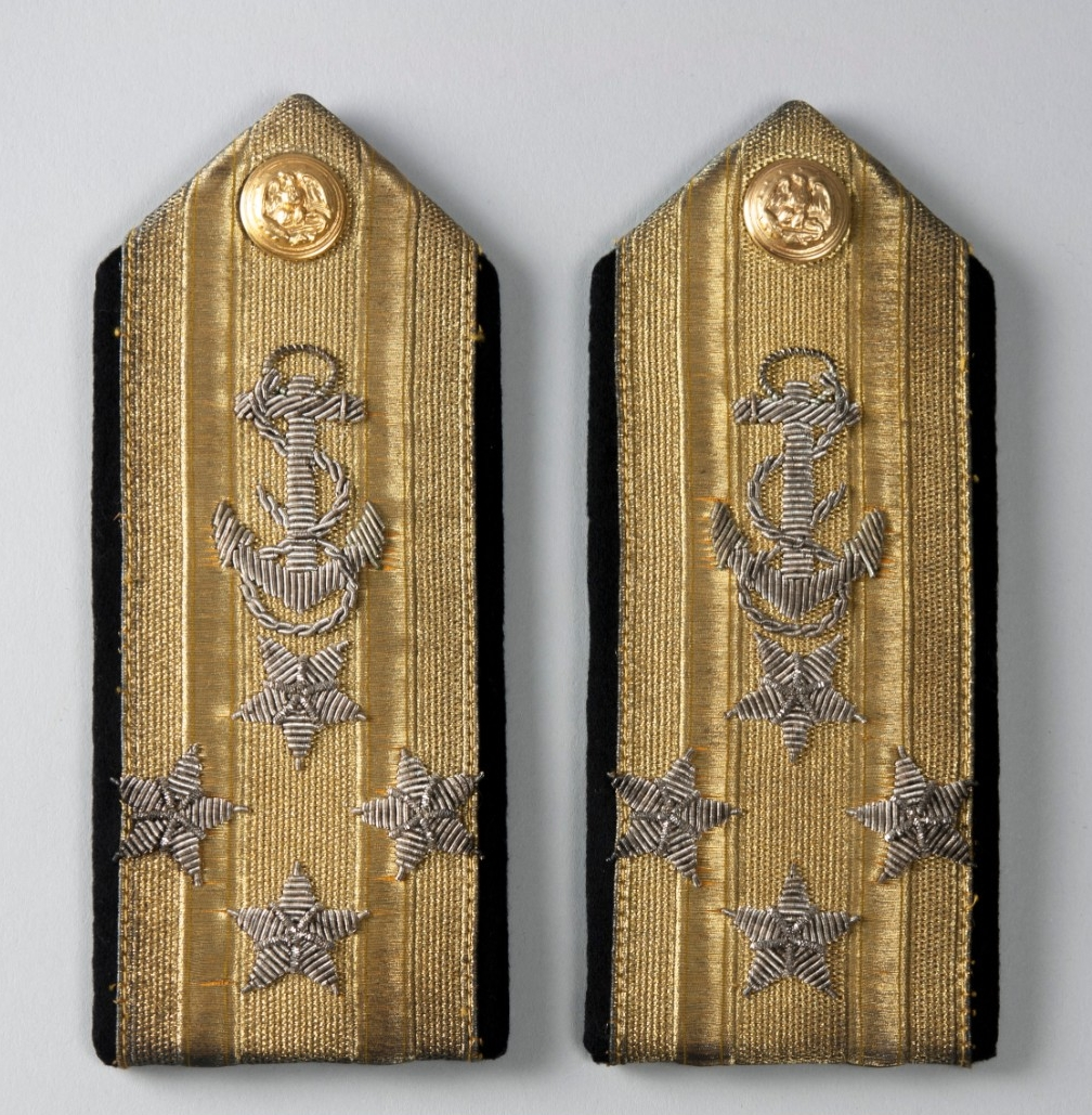 Goldwork with Silver emboridery of anchors and stars pentagon shaped shoulder boards