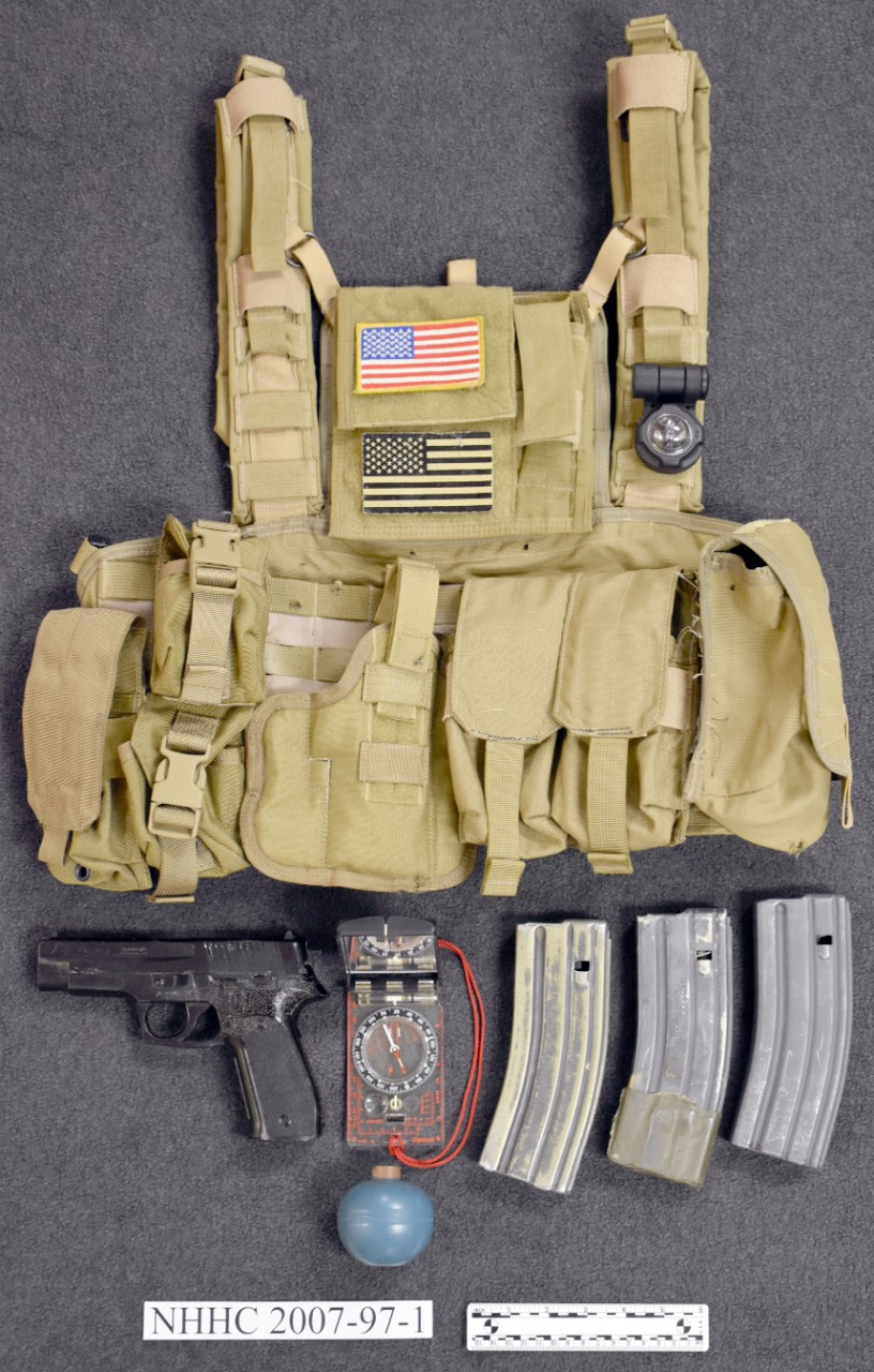 Tan modern tactical vest with magazines, dummy pistol, Grenade and compass with signalling light