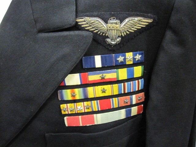<p>Close up view of aviator wings and ribbons</p>