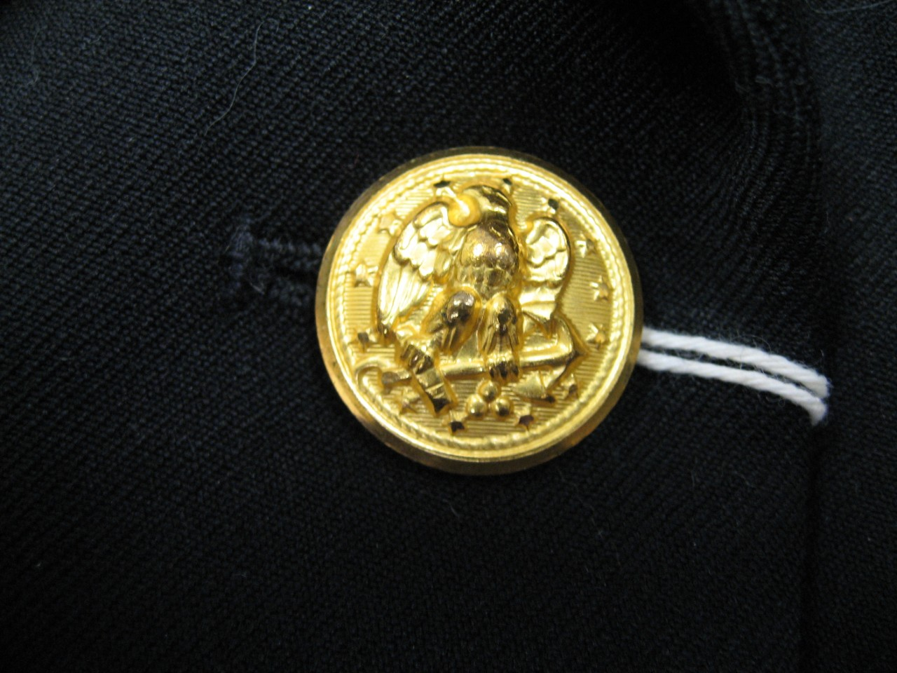 Gilt button worn on the Service Dress Blue uniform coat of a WAVES Chief Petty Officer. Standard Navy button design.