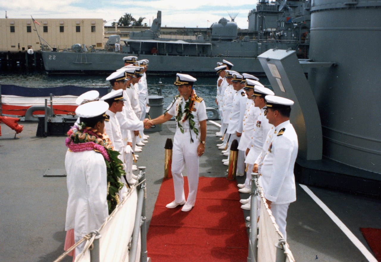 Collection of 47 color photographs related to the change of command onboard USS Goldsborough (DDG-20) at Pearl Harbor, HI, October 9, 1987. The bulk of the imagery shows Commander Melvin Kaahanui relieving Commander Michael Mullen, including speeches and receptions.