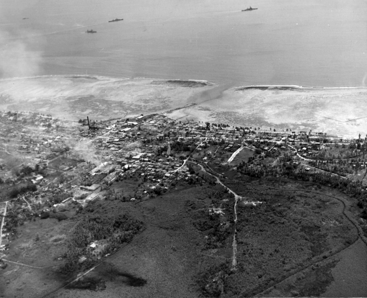 Aerial of Agana, Guam. Photo taken by plane from USS Yorktown (CV-10). September 5, 1944. Photo is from the CAPT Hays R. Browning Photo Collection.