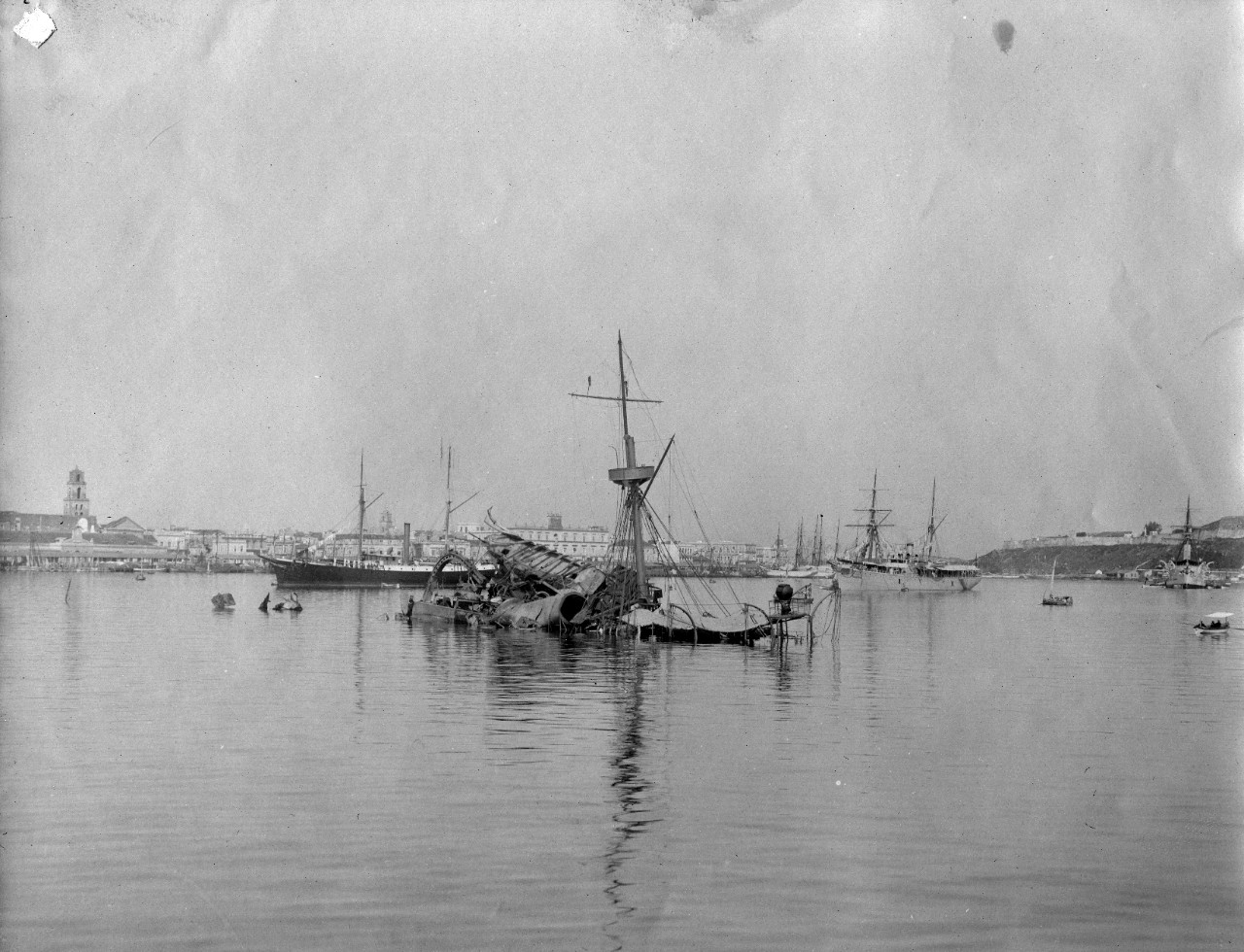 4 sepia photographs of the wreck of USS Maine in Havana Harbor, likely taken days after the incident in 1898. Photos taken by Ensign George Preston Blow, a junior officer on board USS Maine. Donated by his daughter Mrs. Wayne Chatfield Taylor to the Naval Historical Foundation in 1961, and later donated to the Naval History and Heritage Command.