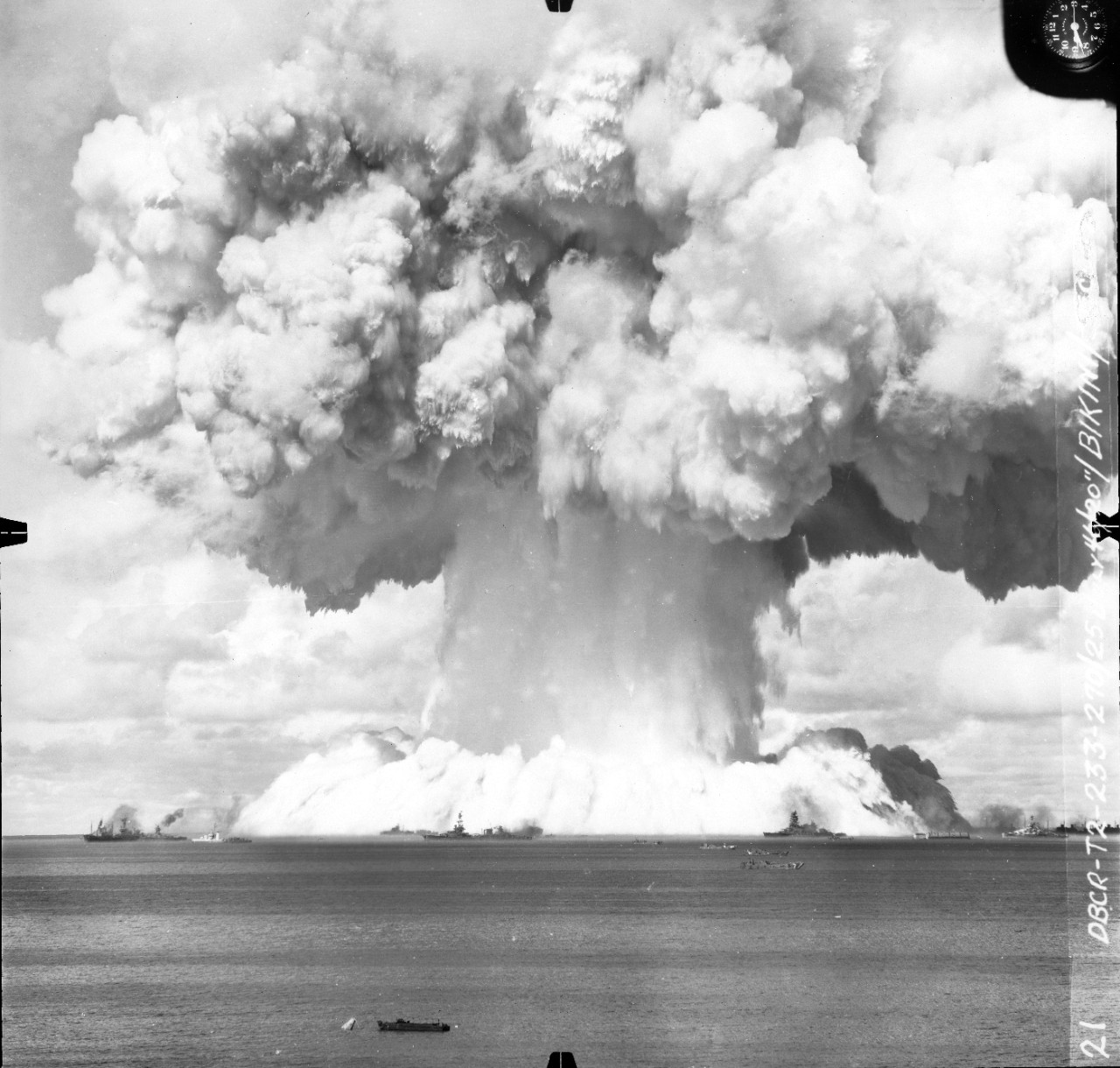 "Collection of 38 photographs of the ""Baker Day"" atomic bomb explosion at Bikini Atoll, Marshall Islands, 25 July 1946. Received from OP-45 prior to 1985. These views are from three different series, one shot from the ground level and the other two taken from aircraft on opposite sides of the explosion site. A full contents listing is below."