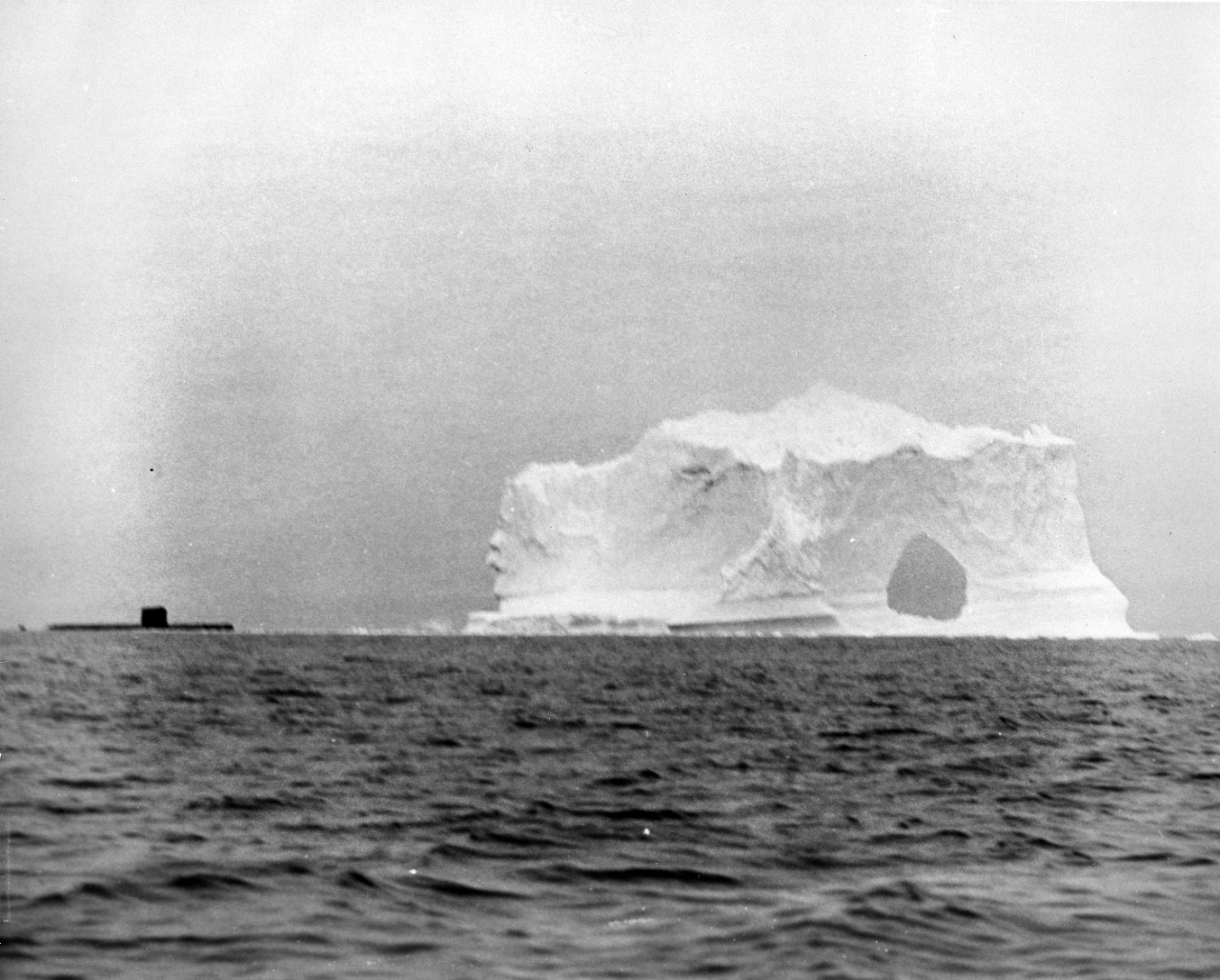 10 photographs of the SEADRAGON (SSN-584) on its first Arctic Cruise in the Fall of 1960. It was the first submarine to travel from the West to the East coast via the Northwest Passage and the first time photographs of the underside of ice formations had been taken. Donor: Admiral Robert L. DENNISON, USN (RET.), ACC # 79-003. Photos from the USN 1050047-1050057 series.