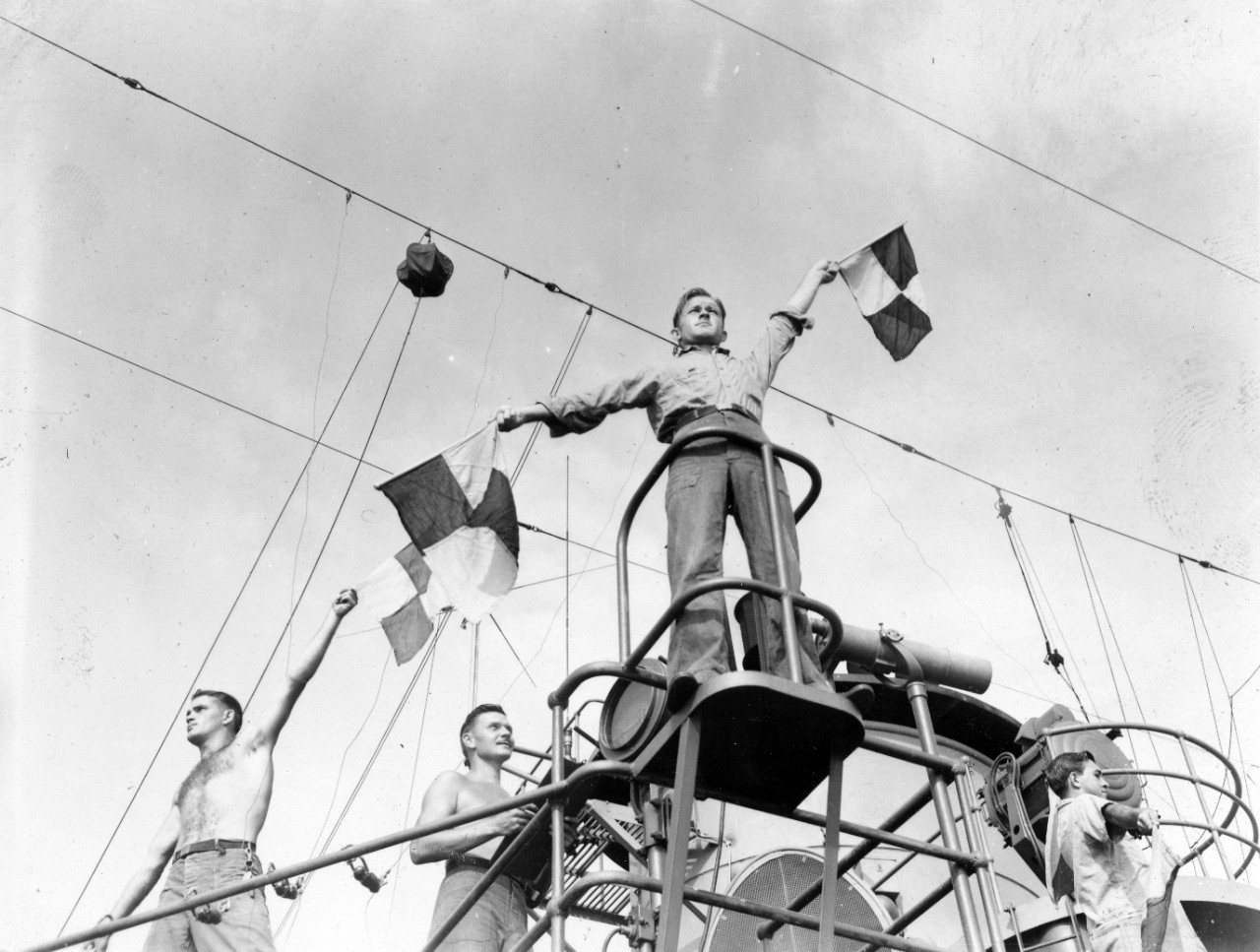 64 photographs related to the naval service of George H. Dunn aboard the USS Cebu (ARG-6) circa 1944-1945. Subject matter of the collection consists of images related to various rooms aboard USS Cebu (laundry, mess, offices, shops, etc.); ship's signalman working with semaphore flags; religious services, music concert, cargo handling; ceremonies; and other onboard activities and crewmembers. There are several good images of officers and crew in formal settings; and are likely organized by the various divisions. Also included are several images of cooks preparing meals, the mess compartment and serving line. Several views include liberty activities on a southern or western Pacific island (buildings, dancing, tug-of-war, drinking beer, etc.).There are item level descriptions for each image in the collection available. Several images from the collection have been given item level numbers from the NH series (NH 106232-NH 106327).
