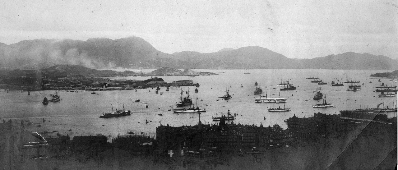 5 black and white photographs donated by Captain Joseph F. Evans, USN (Ret). Views of Punta Arenas, Chile and Guam in 1908. View of Hong Kong harbor circa 1910, with many ships present: USS Cleveland (C-19), USS North Carolina (CA-12), USS Chattanooga (C-16), USS Denver (C-14), USS Helena (PG-9), HMS Hawke, HMS Merlin, HMS Monmouth, HMS King Alfred, HMS Kent, HMS Bedford, HMS Tamar, French protected cruiser D'Entrecasteaux. Some images have been assigned NH numbers.