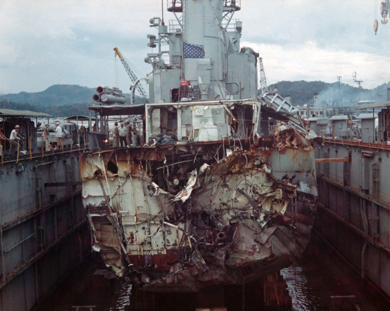 44 color negatives and 7 color prints showing the damaged USS Frank E. Evans (DD-754) being escorted to the auxiliary repair drydock USS Windsor (ADR-22) at Subic Bay, after it had been in involved in a collision with the Australian aircraft carrier HMAS Melbourne on 3 June 1969. Photographer PN2 Ralph Treser. Photos received from PAO CINCPAC Det-WESPAC, 26 April 1971.