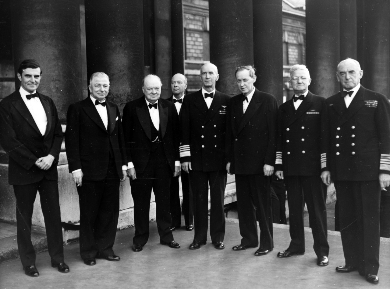 Dignitaries pose on the stops of the Painted Hall after dinner. From left to right: John G. Winant, US Ambassador to the UK; A.V. Alexander, First Lord of the Admirality; Winston Churchill, Prime Minster; William Bullitt, Special Assistant to the US Secretary of the Navy; ADM Ernest J. King, Chief of Naval Operations & Commander in Chief, US Fleet; Harry Hopkins, Special Advisor to President Roosevelt; ADM Harold R. Stark, Commander US Naval Forces in Europe; Admiral of the Fleet, Sir Dudley Pound, First Sea Lord. From the VADM Robert C. Giffen Photo Collection.