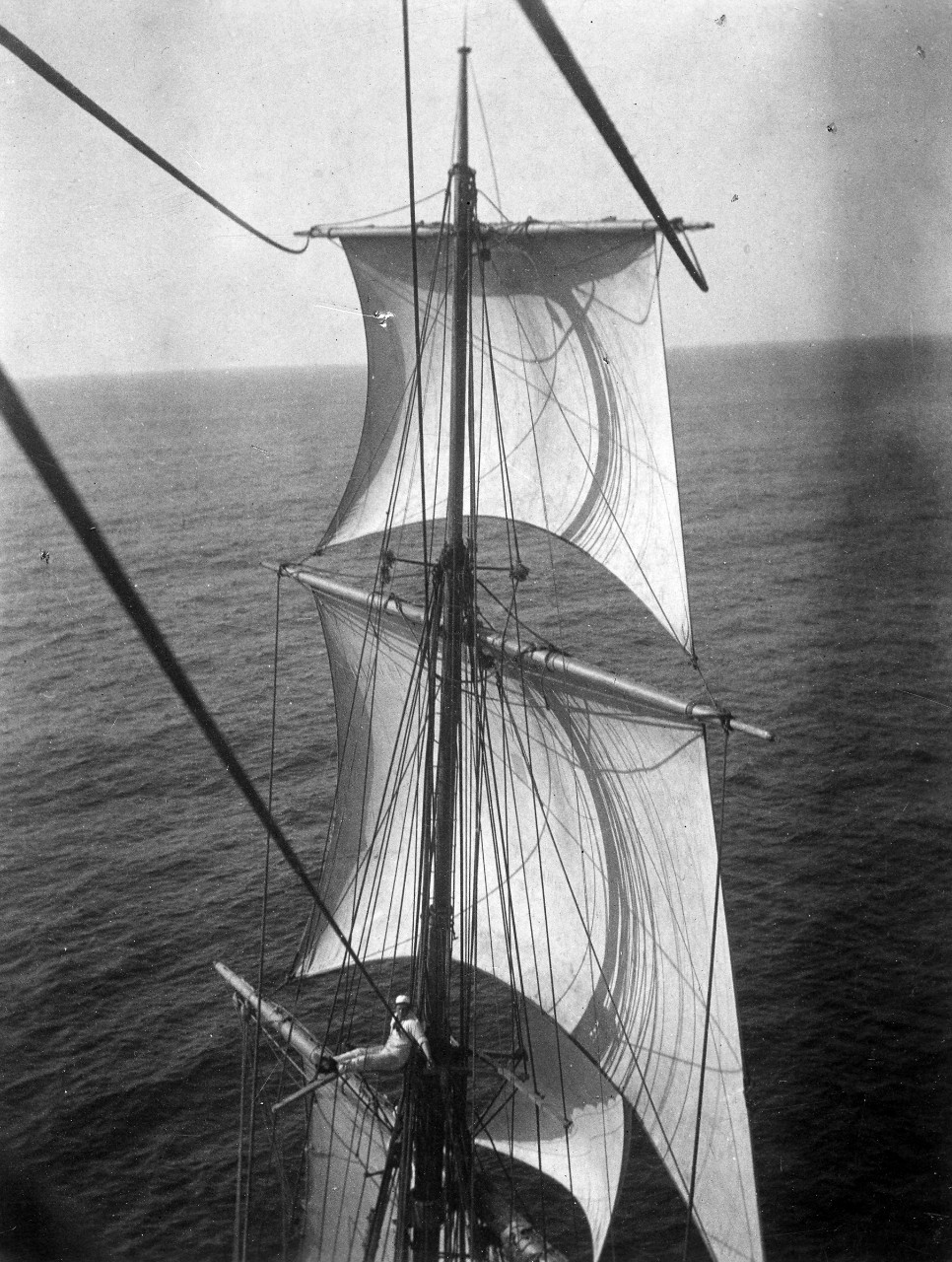 A midshipman sitting in the rigging on the training vessel USS Chesapeake, 1902. He is a member of Naval Academy class of 1905. Image is from the Clarence Grace Collection.
