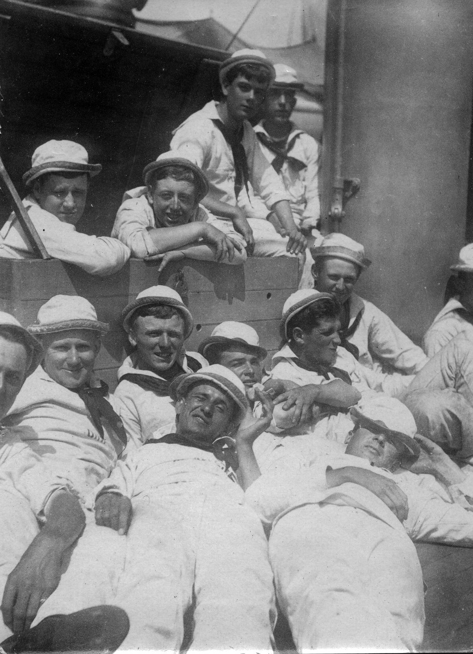 Midshipmen relaxing aboard a training vessel, included are: John Pond, Frank Eklund, Russ Culp, Stanford Hooper, Henry Orr, John Sweeney, Joe Morrison, John Sumpter, & Charles Shaw. The midshipmen are part of the Naval Academy class of 1905. Image is from the Clarence Grace Collection.