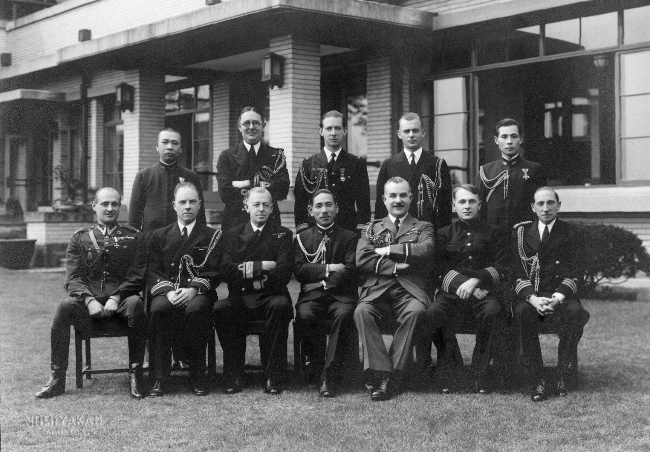 6 black and white photographs mounted in cardboard folders, including 5 oversize prints, of groups of international military officers in Japan, 1939-1941. Included are Xerox copies of the photographs with translations of the names originally printed in Japanese. Officers shown include representatives from Japan, United States, Great Britain, and Germany, along with spouses. Groups shown include the Invitational Tea Club of Foreign Officers and Spouses; Invitational Tea of Wives of Foreign Military Officers; army attachés; and Foreign Military Officers at Invitational Luncheon Club. Photos taken in Tokyo.