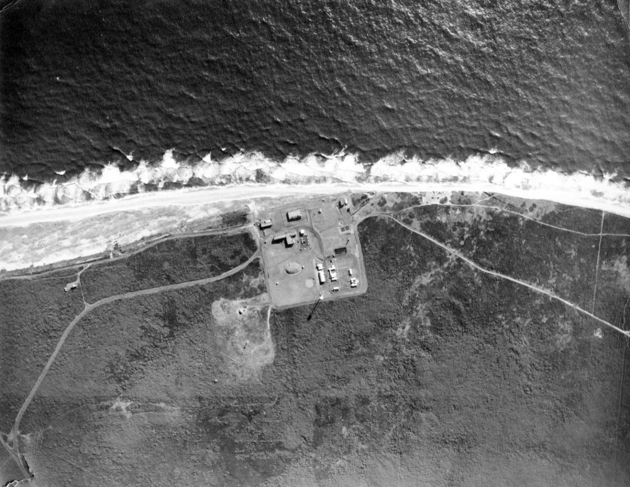 Collection of seven images (several are copies) of aerial views of facilities and beach erosion at the Naval Facility Nantucket, MA, March 1969.