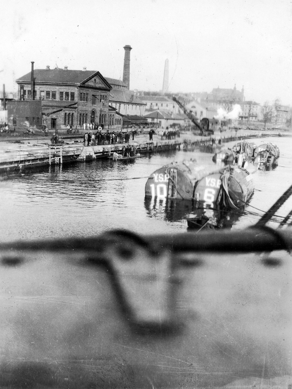 S-4 and pontoons entering drydock in Boston, March 1928. The tow arrived in Boston just ahead of a northeast storm.