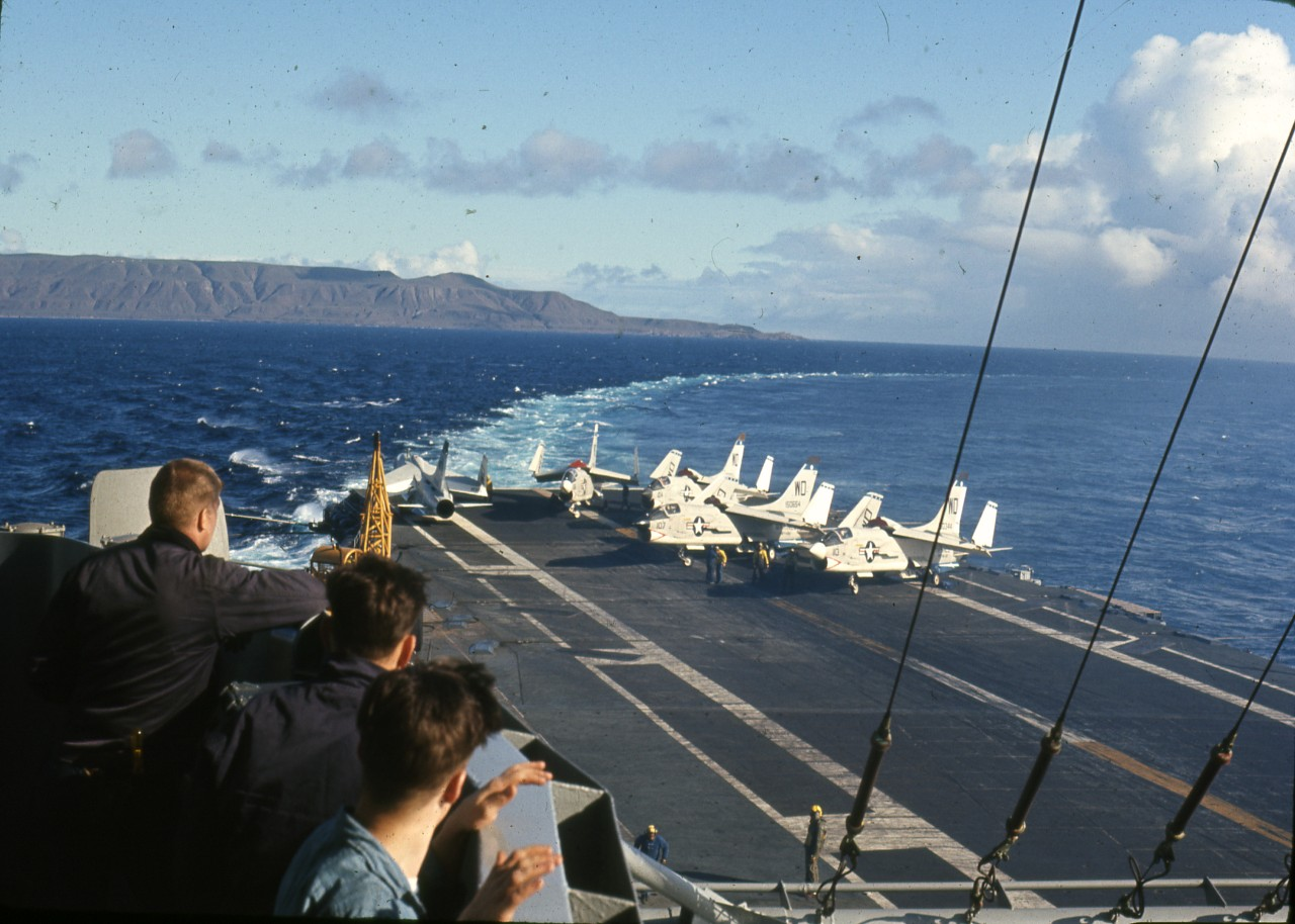 Donation of 220 color slides relating to LCDR Vernon Nolte and his career in the Naval Reserve during his time onboard USS Oriskany and its visit to Cuba, circa 1950s-1960s. Images consist of views of Oriskany (CV-34), including: up-close, at sea, the hanger deck, and flight deck (including E-2 Hawkeye, F-8, A-7, A-4, & A-3), landings/take-off; the USS Constellation in San Diego Bay, 1965; the collection also includes a series of images at NAS Guantanamo Bay, Cuba, 1957 – consisting of aircraft, control tower, various base buildings, aerials taken from aircraft. Miscellaneous imagery includes unidentified ships in Charleston, SC (1966); NAS Miami buildings and aerials; and NAS Minneapolis runway and aircraft.