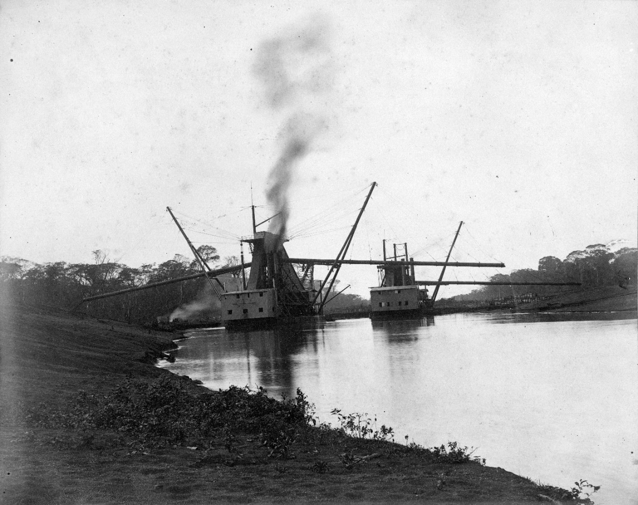 22 oversize photos, mounted on cardboard, showing construction of the failed Nicaragua Canal, circa 1890. Views of clearing of land, and extensive views of dredges and dredging operations. Views of Managua, and buildings near the operation.
