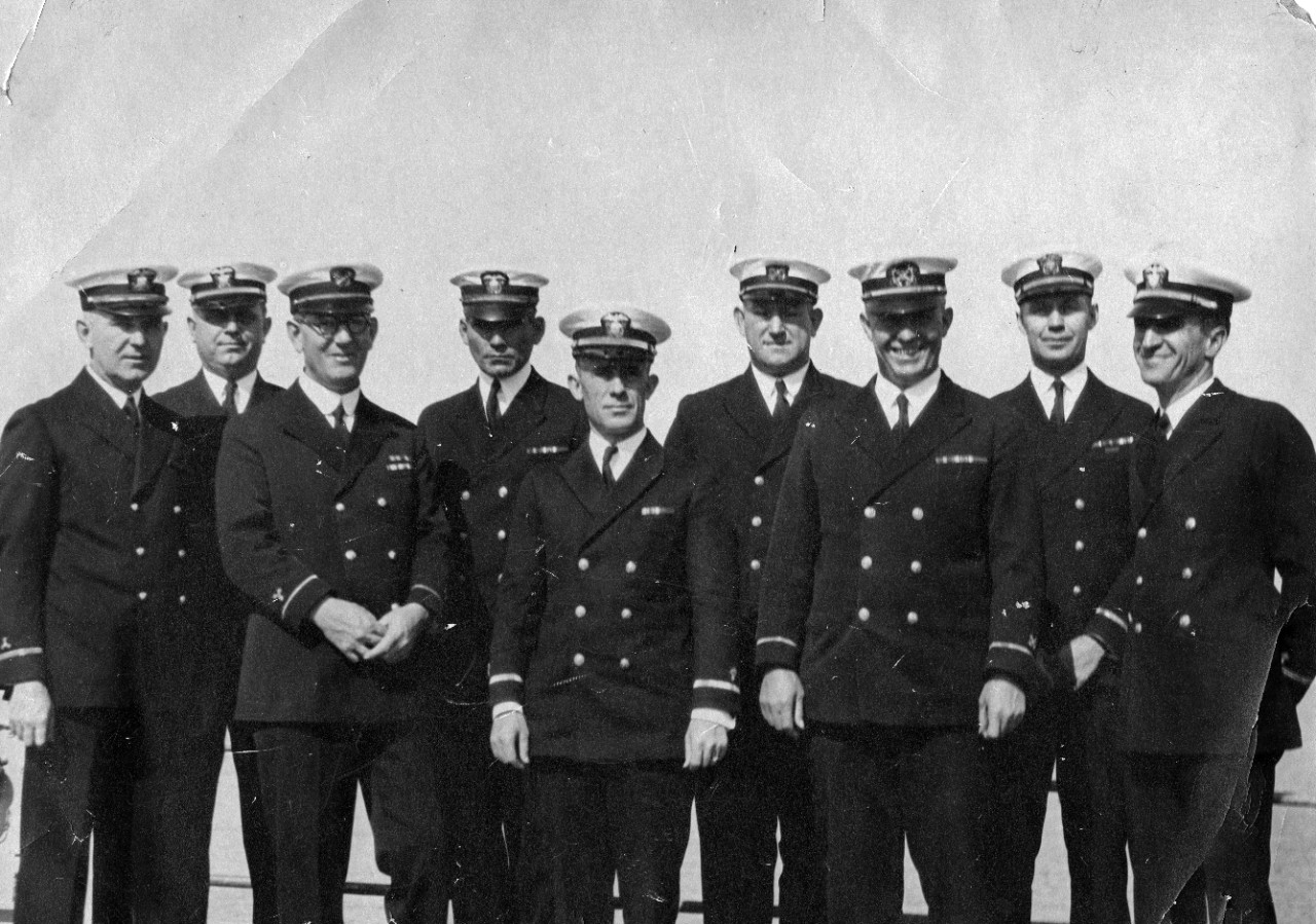 1 black and white photograph showing chiefs and warrant officers of USS Medusa (AR-1) shortly after the ship commissioned in 1924. Shown are: Chief Machinist Z.W. Sherwin, Chief Pay Clerk Albert Fender, Machinist W.J. Lowe, Chief Gunner S.A. Klish, Chief Radio Electrician R.J. Ostrander, Pay Clerk G.A. Howard, Boatswain H.L. Arnold, Chief Carpenter J.A. Kemmler, Chief Electrician C.W. Piper.