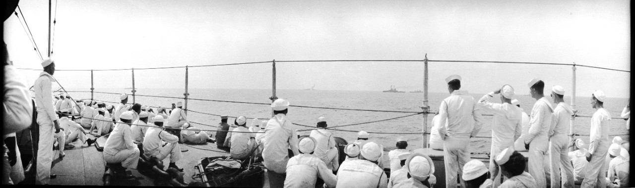 Enlisted sailors observe bombs striking the Ex-SMS Ostfriesland on the horizon during the 1921 Army-Navy bombing exercises off the Virginia capes.