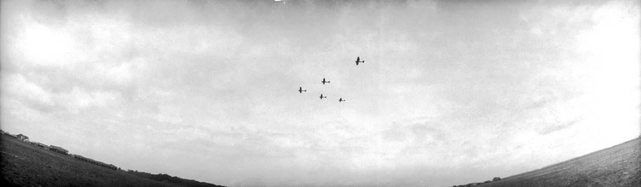 US Army DH-4 airplanes in formation over Langley Field, Virginia. Occasion may be the 1921 Army-Navy bombing exercises off the Virginia capes.