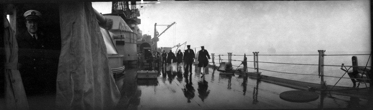 Rainstorm during the Army bombing trials on 20 July 1921, off the Virginia capes. Secretary of the Navy Josephus Daniels walks the deck of a battleship, possibly USS New York (BB-34).