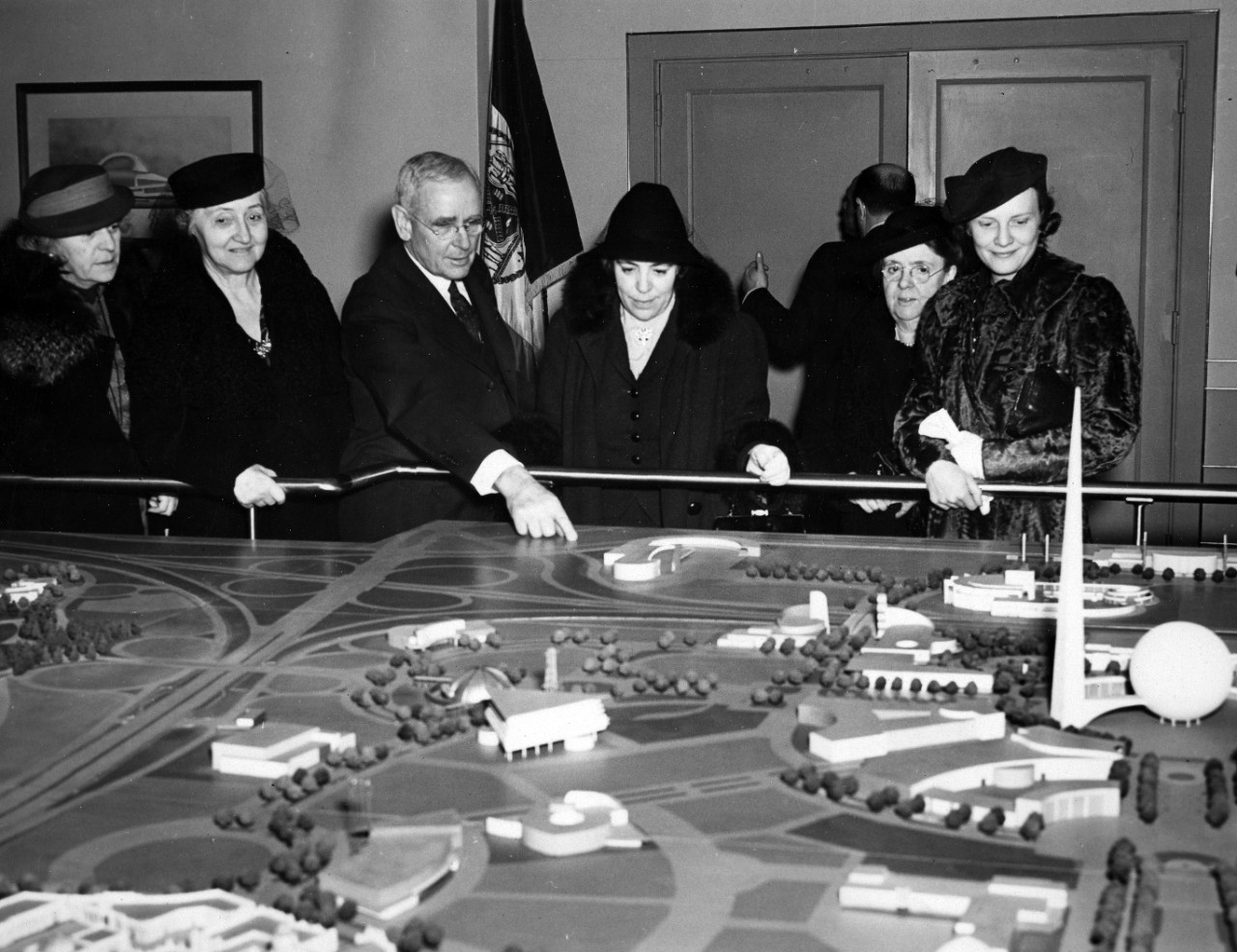 Admiral William H. Standley points out a feature on the miniature model of the 1939 World's Fair in New York City.