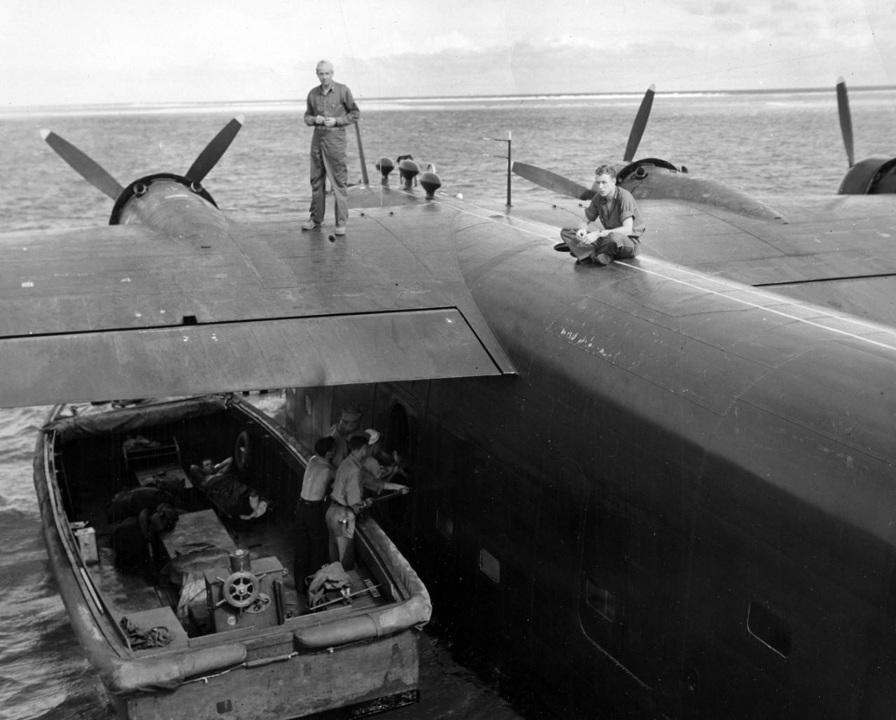 Loading cargo on to Naval Air Transport Service (NATS) aircraft at Ulithi Atoll, 1944.
