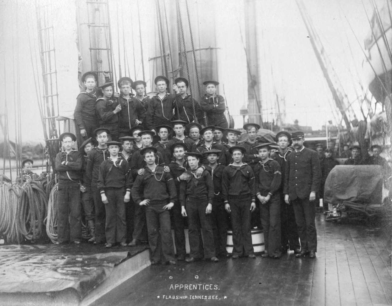 Scrapbook containing crew photos and scenes on board USS Tennessee, circa 1885. Identified individuals include Rear Admiral James Jouett, Midshipman John Ellicott, Captain Oscar Stanton, Passed Assistant Engineer Robert Milligan. Many photos have been assigned NH numbers.