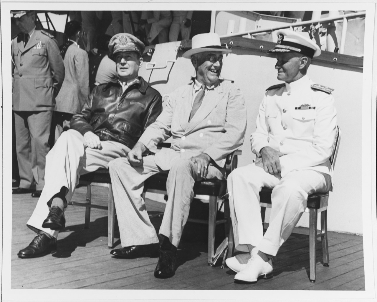 Photo #: 80-G-241479  General Douglas MacArthur, U.S. Army (left); President Franklin D. Roosevelt (center); and Admiral Chester W. Nimitz, USN (right)