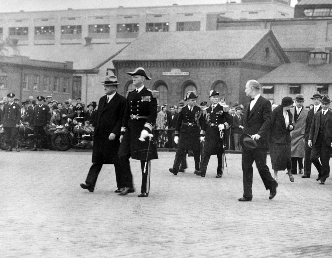 President Herbert Hoover on his way to the presidential barge to inspect USS Constitution at the Washington Navy Yard.