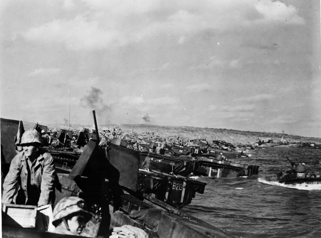 <p>Navy and Coast Guard landing craft of all types crowd onto the assault beach at Iwo Jima to bring the 4th and 5th Marine divisions ashore.</p>
