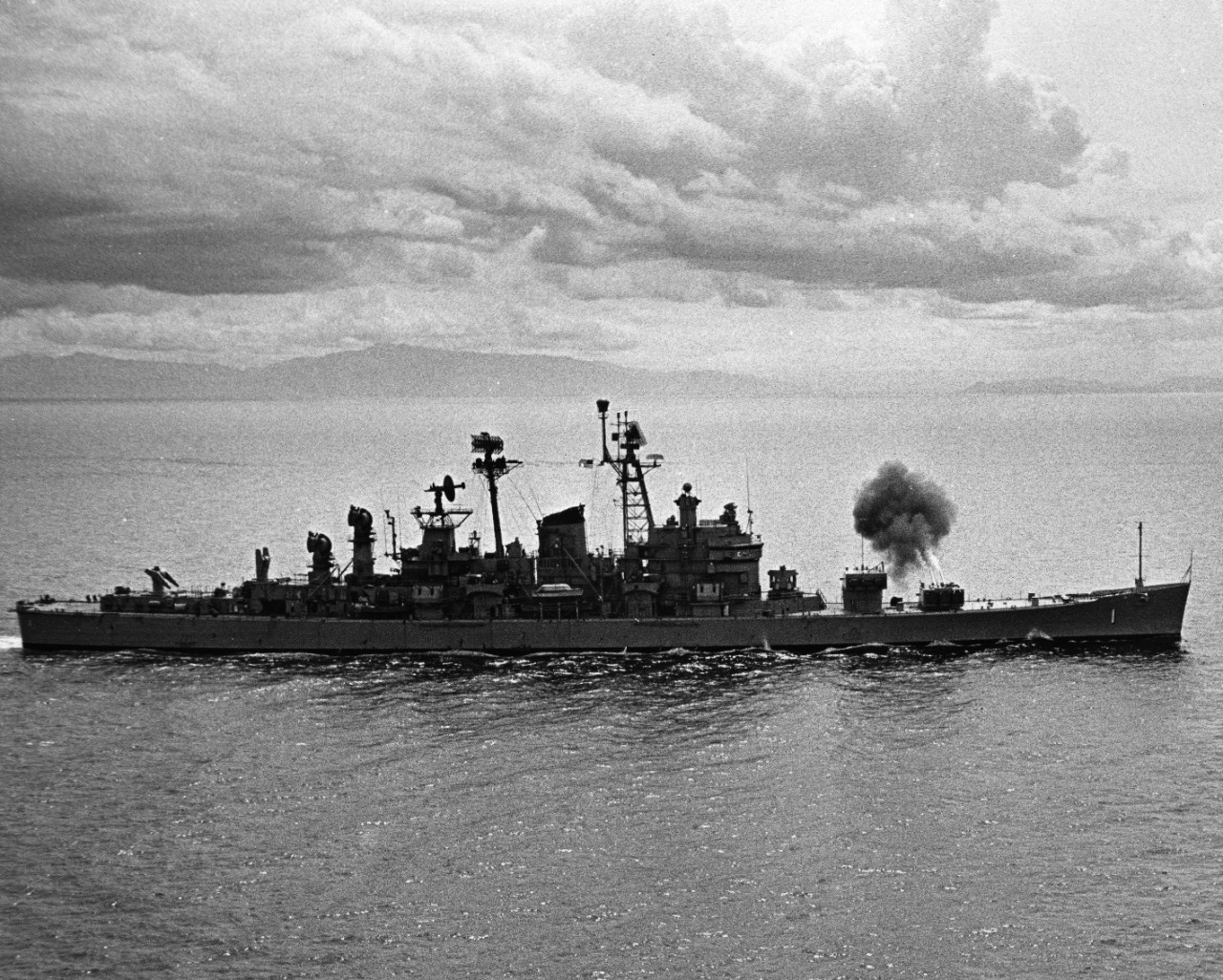 USS Boston (CAG-1) firing her 8 inch guns at North Vietnam WBLCs (Water Borne Logistics Craft) on 9 September 1968.