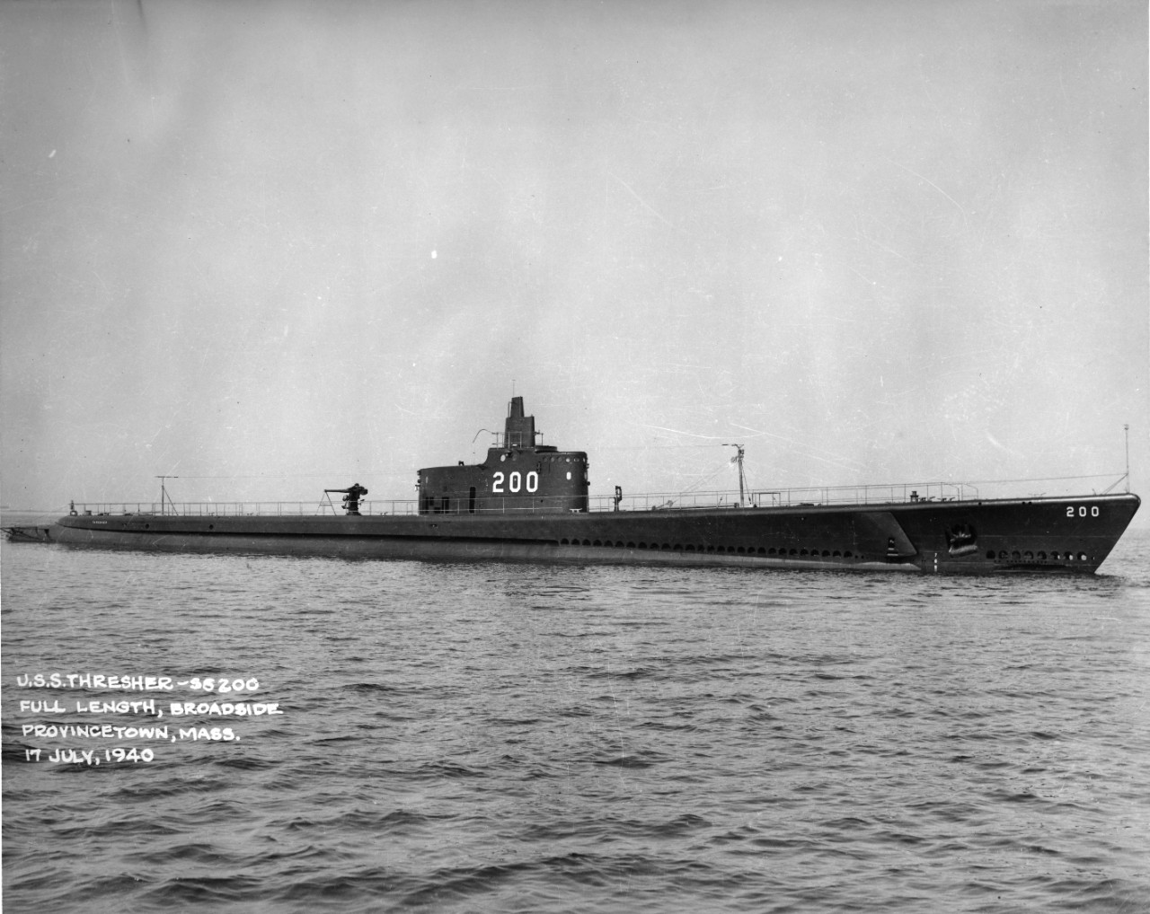 Starboard broadside view of submarine USS Thresher (SS-200) on the surface, off Provincetown, Massachusetts