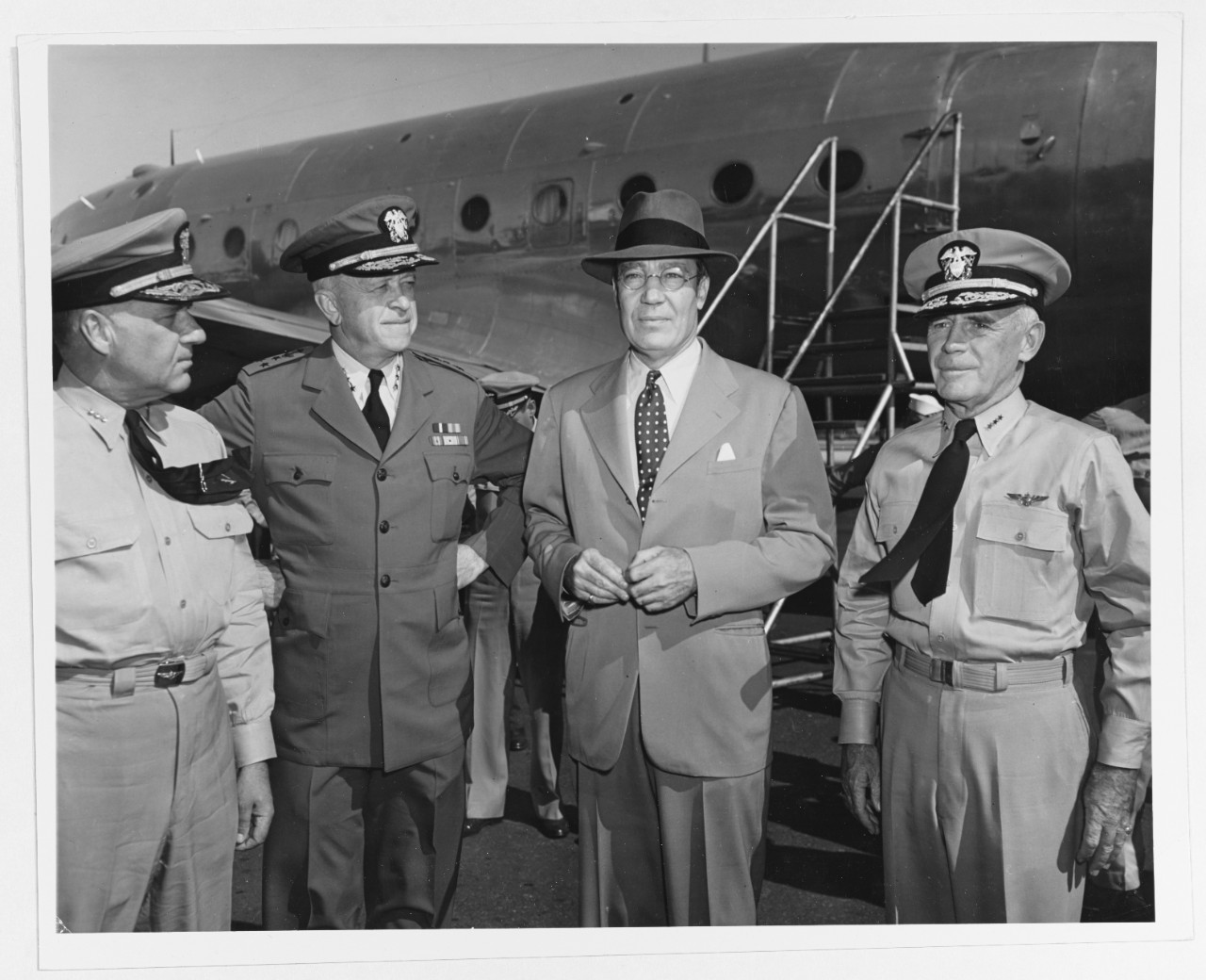 Vice Admiral John H. Towers, U.S. Navy; Vice Admiral Russell Wilson; Mr. Artemus Gates, and Vice Admiral G.D. Murray.