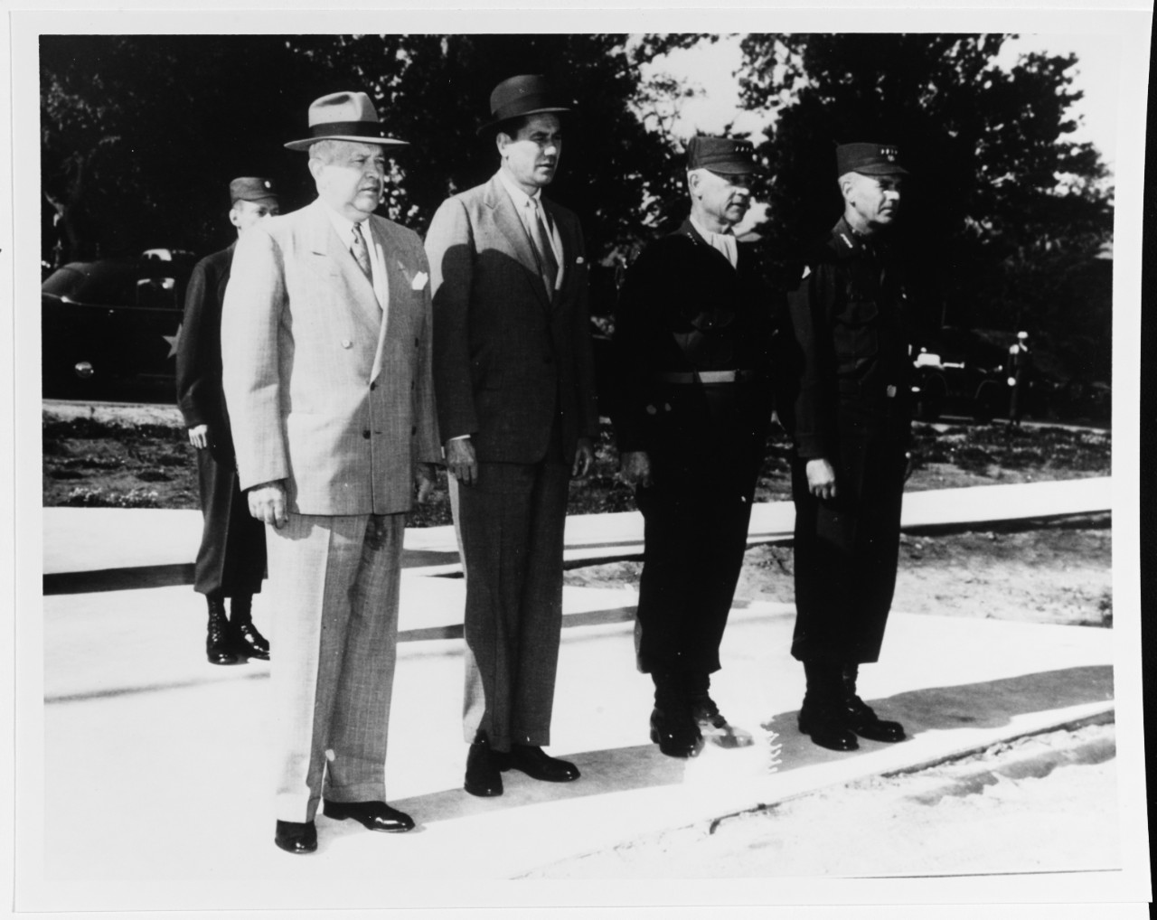 Charles E. Wilson, Secretary of Defense, Thomas S. Gates, Jr., Undersecretary of the Navy, General John E. Hull, and General Maxwell D. Taylor
